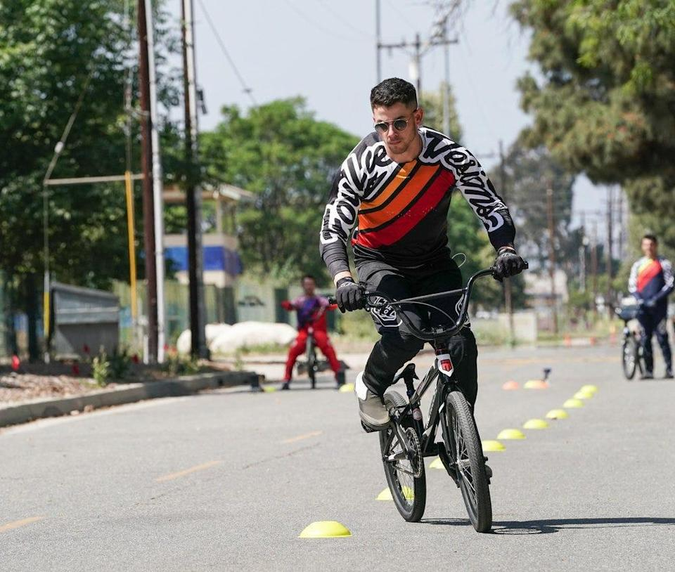 """Nick Jonas has revealed the cause of his May biking injury: a mishap while competing in the BMX race portion of """"Olympic Dreams Featuring Jonas Brothers."""""""