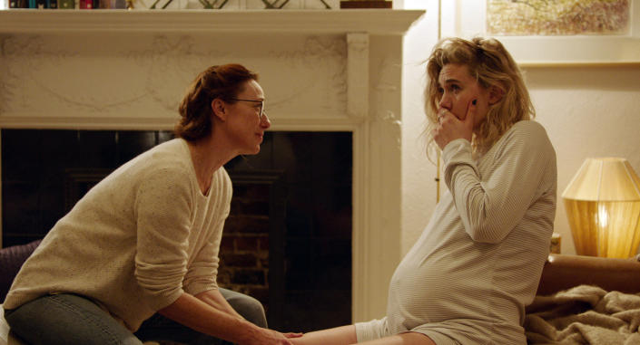 """This image released by Netflix shows Molly Parker, left, and Vanessa Kirby in a scene from """"Pieces of a Woman."""" (Benjamin Loeb/Netflix via AP)"""