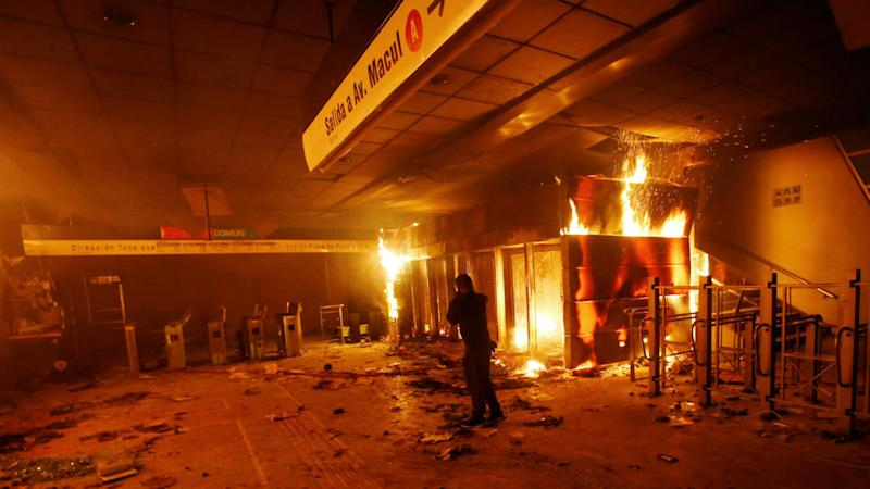 Chile's president declares state of emergency after riots over metro fare