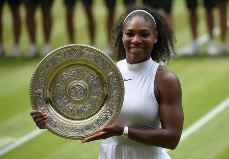 FILE PHOTO: Britain Tennis - Wimbledon - All England Lawn Tennis & Croquet Club, Wimbledon, England - 9/7/16 USA's Serena Williams celebrates winning her womens singles final match against Germany's Angelique Kerber with the trophy REUTERS/Toby Melville Picture Supplied by Action Images/File Photo