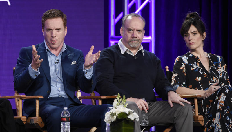 "From left, Damian Lewis, Paul Giamatti and Maggie Siff, cast members in the Showtime series ""Billions,"" take part in a panel discussion on the show at the Television Critics Association Winter Press Tour on Saturday, Jan. 6, 2018, in Pasadena, Calif. (Photo by Chris Pizzello/Invision/AP)"