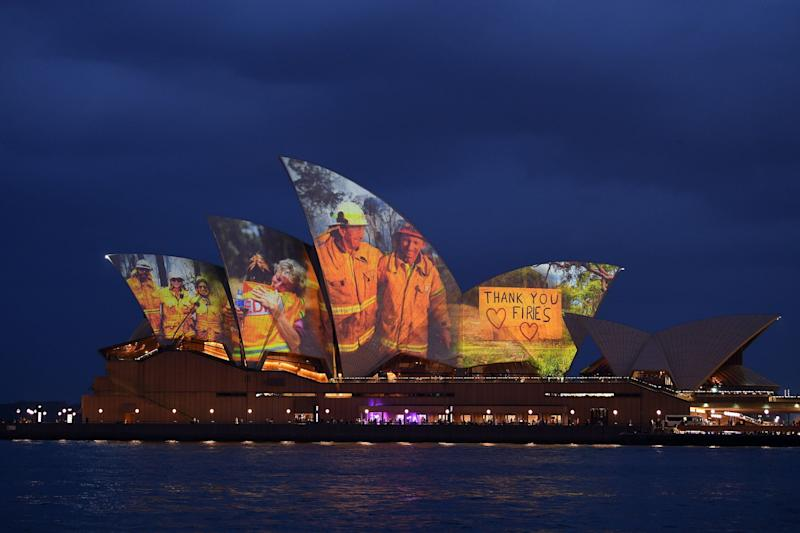 The sails of the Opera House are lit with a series of images to show support for the communities affected by the bushfires and to express the gratitude to the emergency services and volunteers in Sydney on January 11, 2020. - Massive bushfires in southeastern Australia have a