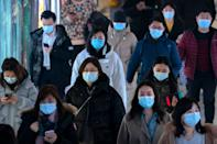 Commuters wearing face masks to protect against the spread of the coronavirus walk through a subway station in Beijing, Wednesday, March 3, 2021. China has been regularly reporting no locally transmitted cases of COVID-19 as it works to maintain control of the pandemic within its borders.