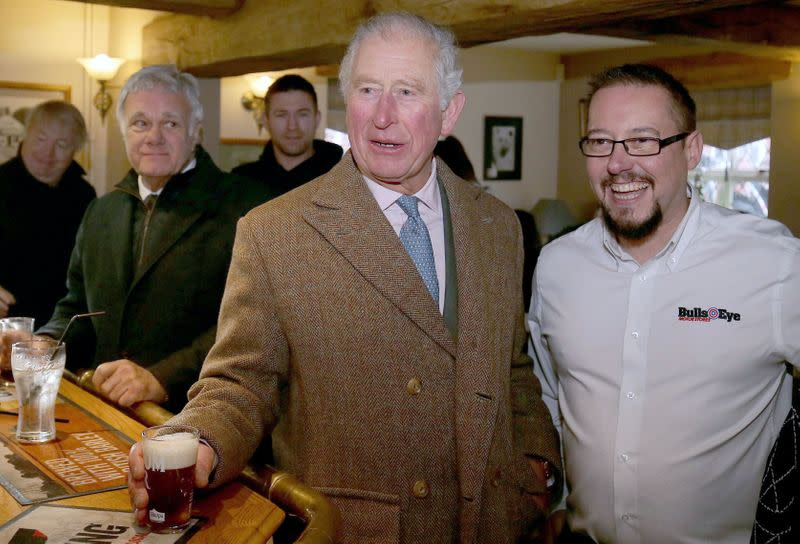 Britain's Prince Charles meets flood victims in Hare and Hounds pub in in Fishlake