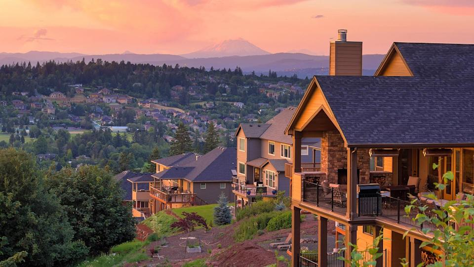 Sunset View with Mount St Helens from deck of luxury homes in Happy Valley Oregon in Clackamas County.