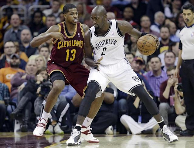 Brooklyn Nets' Kevin Garnett (2) tries to get past Cleveland Cavaliers' Tristan Thompson during the fourth quarter of an NBA basketball game Wednesday, Oct. 30, 2013, in Cleveland. The Cavaliers won 98-94. (AP Photo/Tony Dejak)