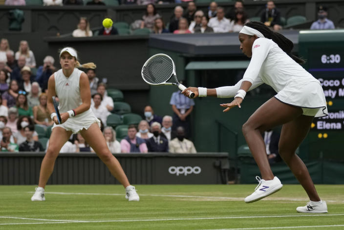 Coco Gauff of the U.S. plays during the women's doubles third round match against Russia's Veronika Kudermetova and Elena Vesnina on day eight of the Wimbledon Tennis Championships in London, Tuesday, July 6, 2021. (AP Photo/Kirsty Wigglesworth)
