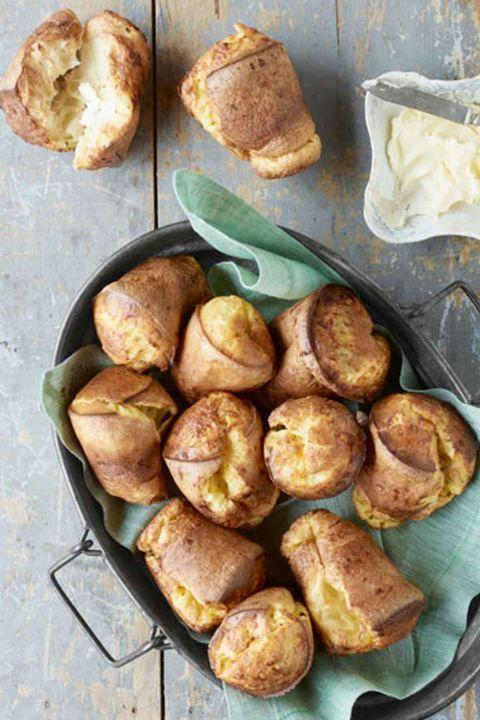"""<p>These cheesy turnovers can be served at any time of the day, even if it's just for a delicious snack. </p><p><em><strong><a href=""""https://www.womansday.com/food-recipes/food-drinks/recipes/a39449/cheddar-popovers-recipe-clv0413/"""" rel=""""nofollow noopener"""" target=""""_blank"""" data-ylk=""""slk:Get the Cheddar Popovers recipe"""" class=""""link rapid-noclick-resp"""">Get the Cheddar Popovers recipe</a>.</strong></em></p>"""