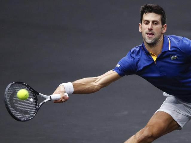 Team Europe's Novak Djokovic hits a return to Team World's Kevin Anderson at the Laver Cup tennis event, Saturday, Sept. 22, 2018, in Chicago. (AP Photo/Kamil Krzaczynski)