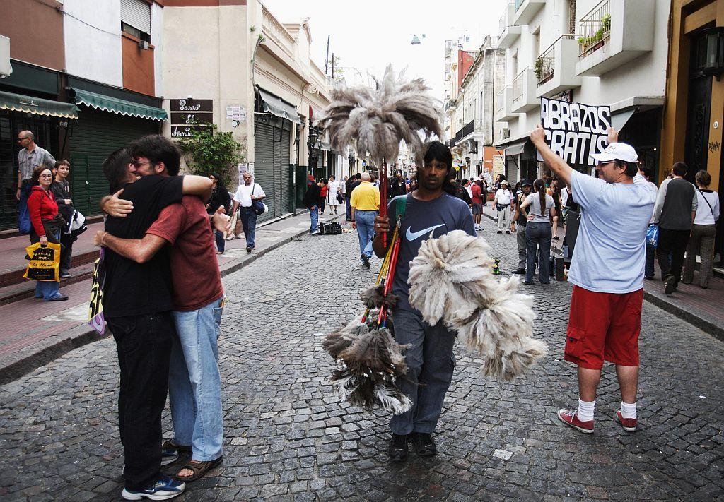 Street artists offer hugs free of charge in Buenos Aires, Argentina.