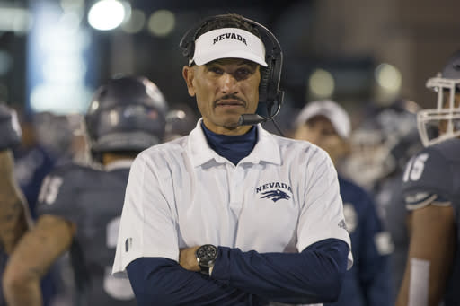 FILE - In this Nov. 2, 2019, file photo, Nevada head coach Jay Norvell works the sideline during the second half of an NCAA college football game against New Mexico in Reno, Nev. Colleges around the country finished off their football signing classes this week, proudly touting scores of African-American athletes as their next big stars. A review of all 130 FBS schools found shockingly low numbers, with blacks still largely shut out of head coaching positions and even more so the prime coordinator spots. (AP Photo/Tom R. Smedes, File)