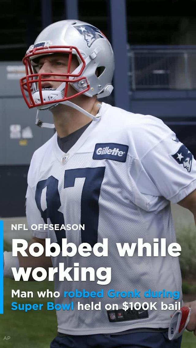 One of three men charged with breaking into New England Patriots' tight end Rob Gronkowski's house while the tight end was in Minneapolis playing in Super Bowl LII was arraigned in a Massachusetts court on Wednesday.