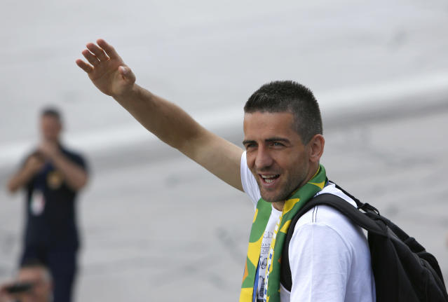 Bosnia's player Vedad Ibisevic waves to supporters at Sarajevo Airport, Bosnia, Tuesday, May 27, 2014 from where they are flying to the United States to play pre-World Cup friendly matches. Bosnia will face Argentina, Iran and Nigeria in group F of the World Cup finals of Brazil 2014. (AP Photo/Amel Emric)