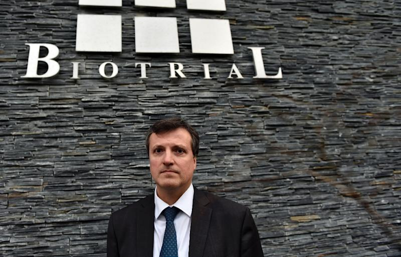 Biotrial general director Francois Peaucelle poses in front of the Biotrial logo at the society headquarters, in Rennes, western France, on January 16, 2016 (AFP Photo/Loic Venance)