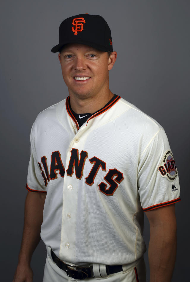 File-This Feb. 2018, file photo shows Nick Hundley of the San Francisco Giants baseball team. The Oakland Athletics added depth at catcher on Monday, Feb. 11, 2019, agreeing to a minor league contract with Hundley. If added to the 40-man roster, the 35-year-old would get a one-year contract paying a $1.25 million salary while in the major leagues. (AP Photo/Ben Margot, File)