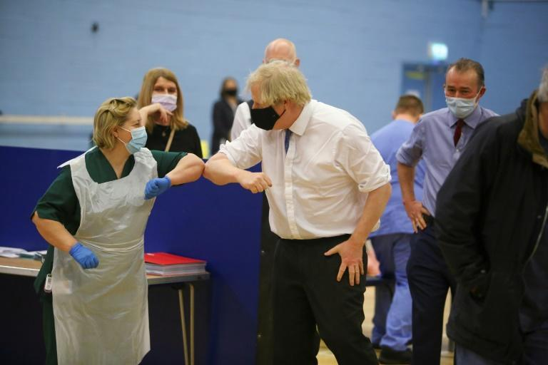 Britain's Prime Minister Boris Johnson visits a vaccination site at Cwmbran Stadium in Wales