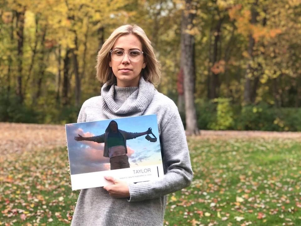 Jordan Brazier holds an image of her younger brother, Taylor, who died at 26 in custody in B.C., in September 2020. She wants more answers about his death but says there has been very little communication from the B.C. Coroners Service, which says its investigation is still open. (Jordan Brazier - image credit)