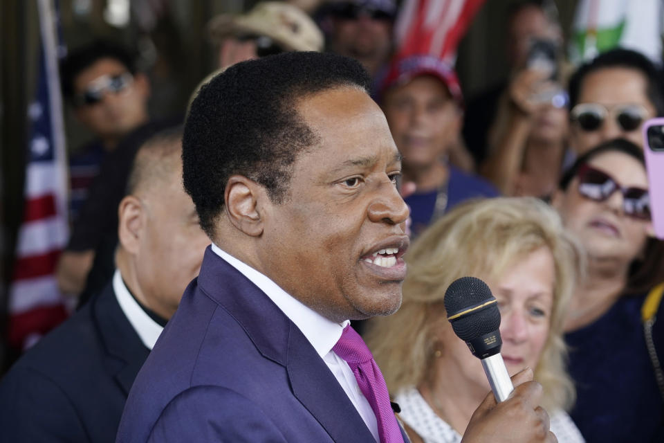 FILE - In this July 13, 2021, file photo, gubernatorial candidate and radio talk show host Larry Elder speaks to supporters during a campaign stop in Norwalk, Calif. In two short months, Larry Elder emerged from the province of conservative talk radio to dominate the Republican field in the California recall election that could remove Democratic Gov. Gavin Newsom from office, drawing national headlines, attracting fervent crowds to his rallies and quickly banking millions of dollars for his first campaign. (AP Photo/Marcio Jose Sanchez, File)