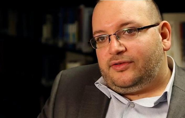 A November 6, 2013 photo provided by the Washington Post shows reporter Jason Rezaian at the newspaper's office in Washington (AFP Photo/Zoeann Murphy)