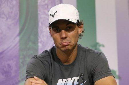 Rafael Nadal of Spain attends a news conference after being defeated by Nick Kyrgios of Australia in their men's singles tennis match at the Wimbledon Tennis Championships, in London July 1, 2014. REUTERS/Scott Heavey/AELTC/Pool