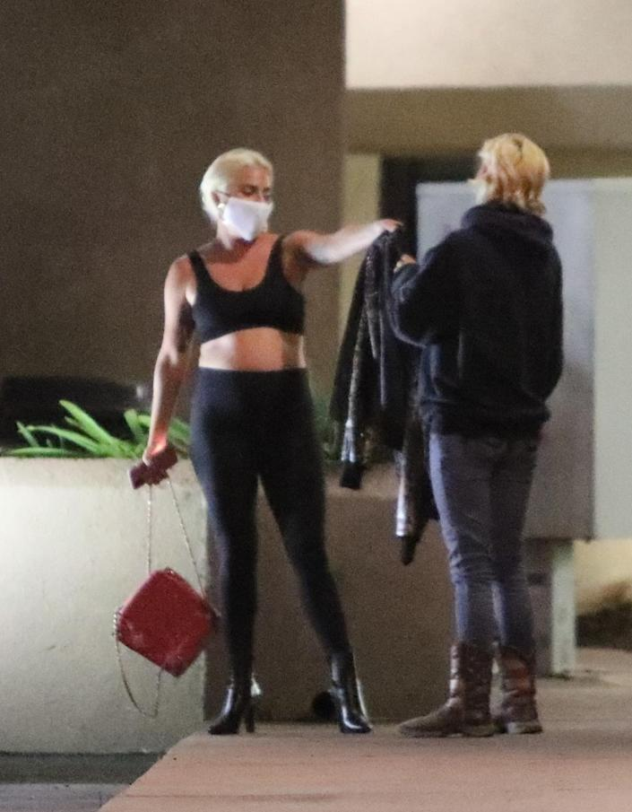 Lady Gaga gives her leather jacket to a fan in Malibu (RMBI/BACKGRID)