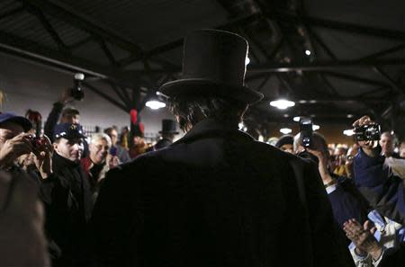 A re-enactor portraying former U.S. President Abraham Lincoln (C) is welcomed at the Gettysburg, Pennsylvania train station November 18, 2013. REUTERS/Gary Cameron