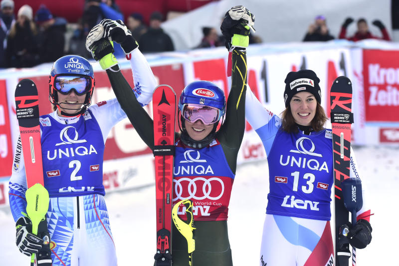 From left, second placed Slovakia's Petra Vlhova, first placed United States' Mikaela Shiffrin and third placed Switzerland's Michelle Gisin celebrate after completing an alpine ski, women's World Cup slalom in Lienz, Austria, Sunday Dec. 29, 2019. (AP Photo/Pier Marco Tacca)