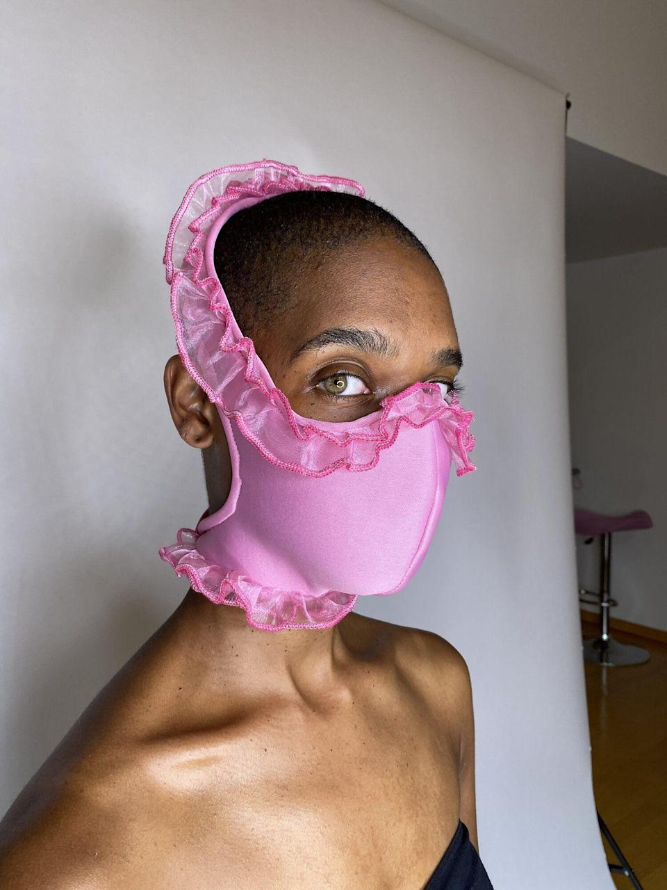 "<p><strong>Tia Adeola</strong></p><p>slashedbytia.net</p><p><strong>$45.00</strong></p><p><a href=""https://www.slashedbytia.net/shop/pink-ruffle-face-mask"" rel=""nofollow noopener"" target=""_blank"" data-ylk=""slk:Shop Now"" class=""link rapid-noclick-resp"">Shop Now</a></p><p>This mask doesn't have an explicit royal connection per se, but it is guaranteed to make you feel like a princess. </p>"