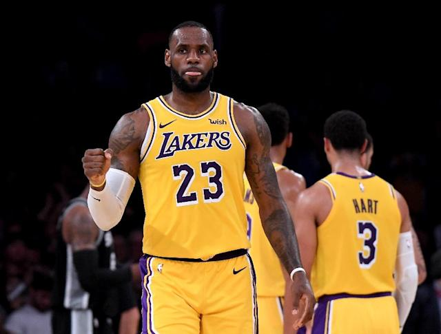 LeBron James finished with 28 points, 11 rebounds and 11 assists for his first triple-double as a Laker (AFP Photo/Harry How)