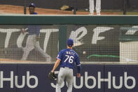 Texas Rangers left fielder Eli White watches a home run by Los Angeles Angels' Albert Pujols fall on the other side of the fence during the fifth inning of a baseball game Friday, Sept. 18, 2020, in Anaheim, Calif. (AP Photo/Ashley Landis)