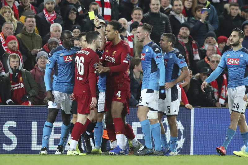 Liverpool's Andrew Robertson, 26, argues with Napoli players including Kalidou Koulibaly, left, during the Champions League Group E soccer match between Liverpool and Napoli at Anfield stadium in Liverpool, England, Wednesday, Nov. 27, 2019. (AP Photo/Jon Super)