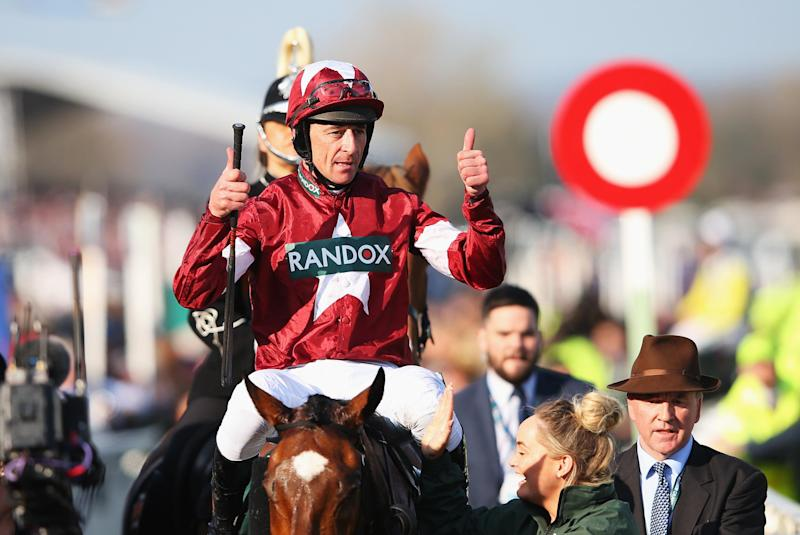 Davy Russell celebrates his win in the 2018 Grand National on Tiger Roll Photo: Getty Images