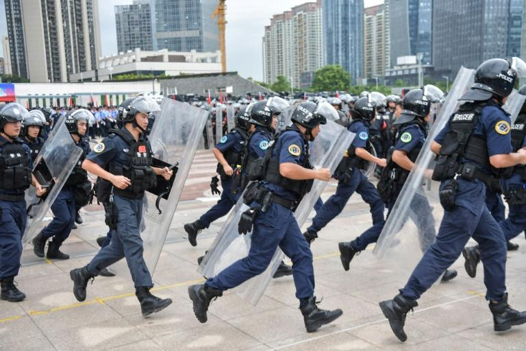 As the clashes between pro-democracy demonstrators and police in the former British colony have grown increasingly violent, Beijing's condemnation has become more ominous (AFP Photo/STR)