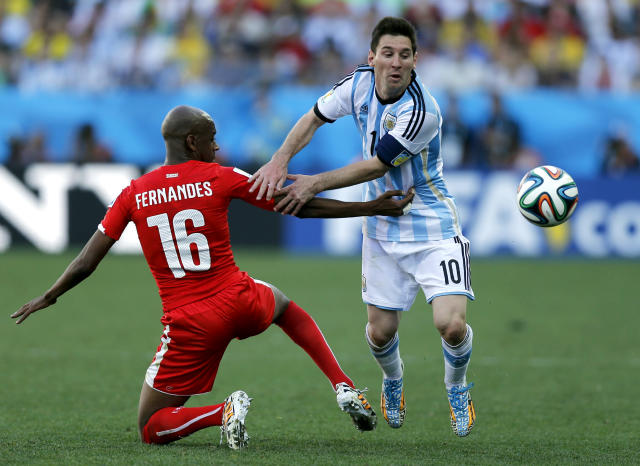 Argentina's Marcos Rojo tries to stop Argentina's Lionel Messi during the World Cup round of 16 soccer match between Argentina and Switzerland at the Itaquerao Stadium in Sao Paulo, Brazil, Tuesday, July 1, 2014. (AP Photo/Victor R. Caivano)