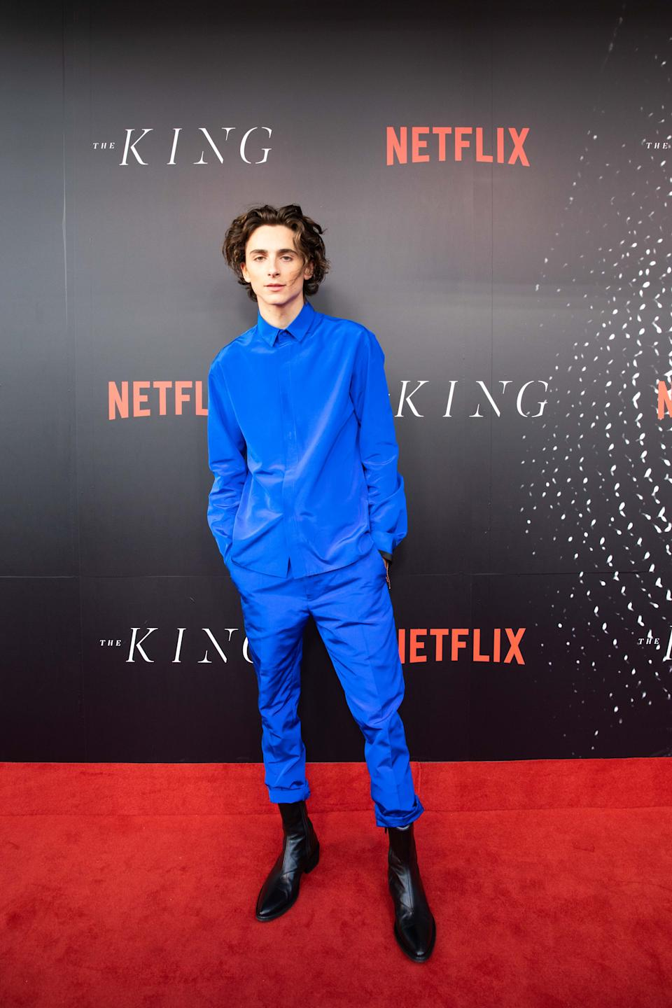 A photo of Timotheé Chalamet wearing a blue shirt and pants at The King Sydney premiere.