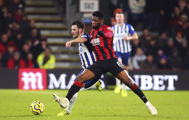Brighton and Hove Albion's Pascal Gross, left, and Bournemouth's Jefferson Lerma during their English Premier League soccer match at the Vitality Stadium in Bournemouth, England, Tuesday Jan. 21, 2020. (Mark Kerton/PA via AP)