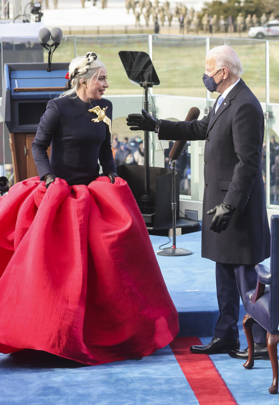 U.S. President-elect Joe Biden gestures towards singer Lady Gaga during his inauguration as the 46th President of the United States on the West Front of the U.S. Capitol in Washington,
