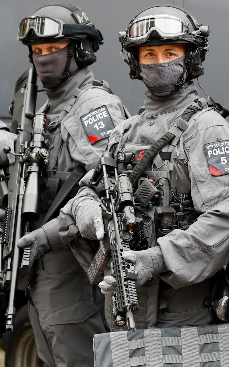 Armed counter-terrorism officers pose during a media opportunity in London. - Credit: AP