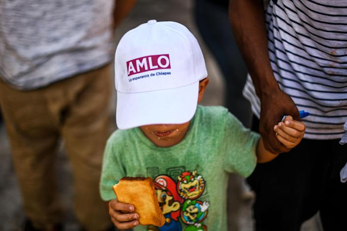 A migrant boy heading in a caravan to the U.S. walks on the road linking Ciudad Hidalgo and Tapachula, Chiapas state, Mexico, on Oct. 21, 2018. (Photo: Pedro Pardo / AFP/Getty Images)
