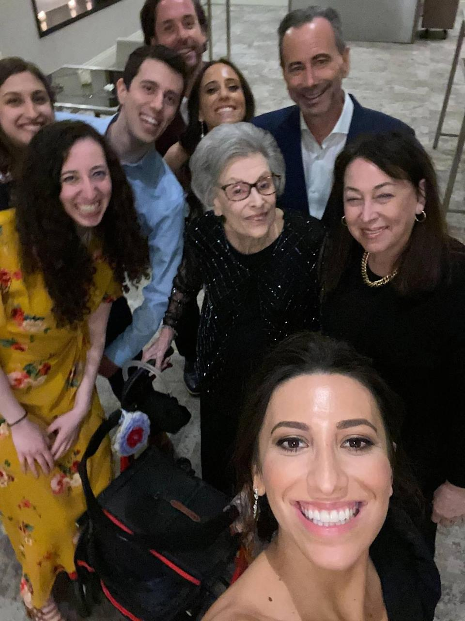 Lily Aaronson (center) with her two children, including her son Geoffrey (top right) and her grandchildren at her granddaughter's wedding on Feb. 29, 2020, at the Eden Roc hotel in Miami Beach.