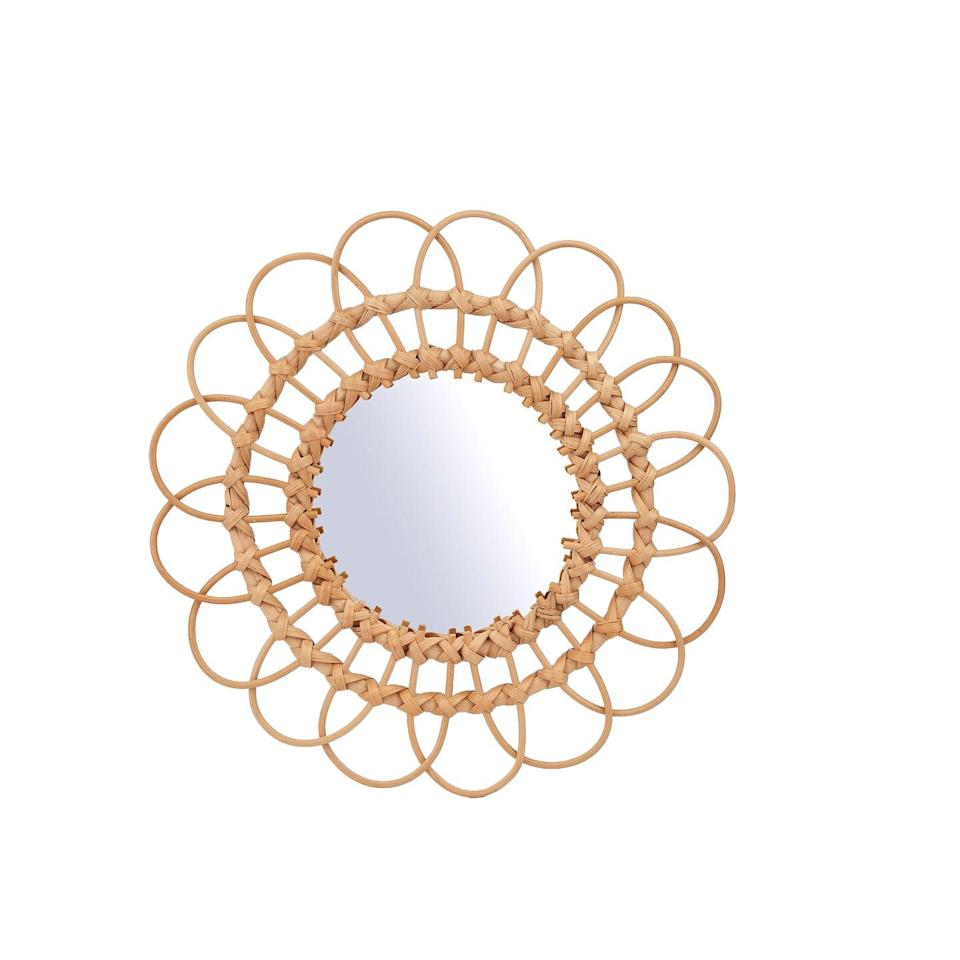 """<p>Add a little bohemian style to your home with this mirror framed by decorative loops of rattan. Pair with pastel colours and plenty of soft, comforting accessories for a craft-influenced look with a comforting quality. £20, <a href=""""https://www.sassandbelle.co.uk/homeware/room-decor/mirrors-wall-decorations/rattan-mirror-medium/?gclid=CjwKCAjwhaaKBhBcEiwA8acsHBwF53G3I6MtNXRc1QDKORn6siTZjo4lqt5cpUsae8WLMl3WEgX0MxoCtTQQAvD_BwE#fo_c=2549&fo_k=1eb1a3b3373ae78584d02e173e129801&fo_s=gplauk"""" rel=""""nofollow noopener"""" target=""""_blank"""" data-ylk=""""slk:sassandbelle.co.uk"""" class=""""link rapid-noclick-resp"""">sassandbelle.co.uk</a></p>"""