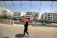 Dubai residents often leave for cooler climates during the hottest months, while many who stay spend their time scurrying between air-conditioned locations -- or rely on delivery drivers for a panoply of services (AFP/Karim SAHIB)