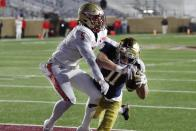 Notre Dame wide receiver Ben Skowronek (11) makes a touchdown reception against Boston College defensive back Deon Jones (5) during the first half of an NCAA college football game, Saturday, Nov. 14, 2020, in Boston. (AP Photo/Michael Dwyer)