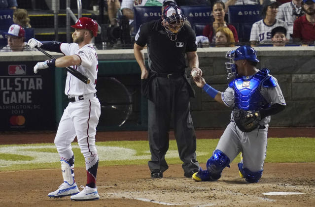 Washington Nationals Bryce Harper walks off the field after striking out in the fourth inning of the Major League Baseball All-star Game, Tuesday, July 17, 2018 in Washington. (AP Photo/Carolyn Kaster)