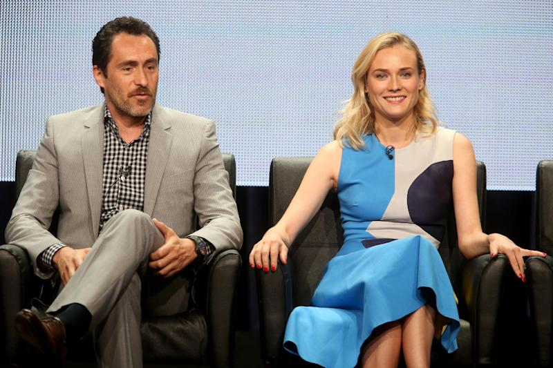 Actors Demian Bichir (L) and Diane Kruger speak onstage at 'The Bridge' panel at The Beverly Hilton Hotel on July 21, 2014 in California (AFP Photo/Frederick M. Brown)