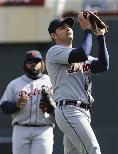 Detroit Tigers pitcher Anibal Sanchez fields an infield popup for the out off the bat of Minnesota Twins' Pedro Florimon in the third inning of a baseball game Sunday, Sept. 30, 2012 in Minneapolis. Watching, left, is Tigers first baseman Prince Fielder. (AP Photo/Jim Mone)