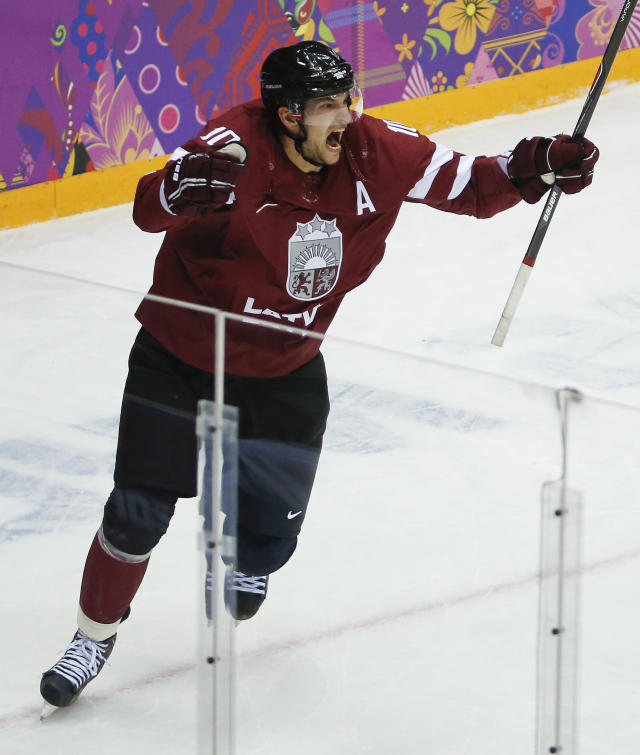 Latvia forward Lauris Darzins reacts after scoring a goal against Canada during the first period of a men's quarterfinal ice hockey game at the 2014 Winter Olympics, Wednesday, Feb. 19, 2014, in Sochi, Russia. (AP Photo/Mark Humphrey)