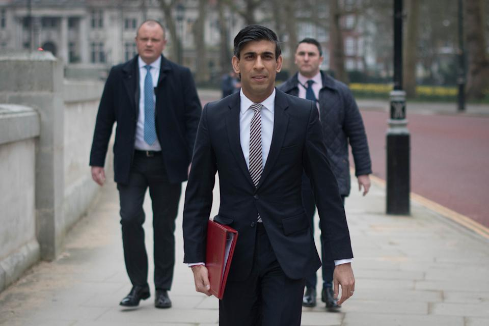 Chancellor of the Exchequer, Rishi Sunak, walks from the Treasury to No 11 Downing Street, London, the day before delivering his budget. Picture date: Tuesday March 2, 2021.