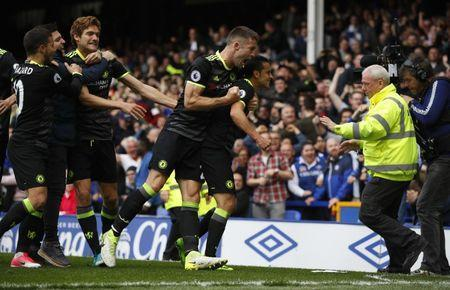 Britain Football Soccer - Everton v Chelsea - Premier League - Goodison Park - 30/4/17 Chelsea's Pedro celebrates scoring their first goal with teammates as a fan invades the pitch Reuters / Phil Noble Livepic