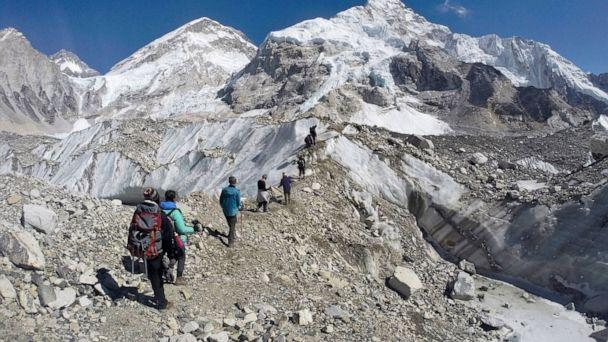 PHOTO: In this Monday, Feb. 22, 2016 file photo, trekkers pass through a glacier at the Mount Everest base camp, Nepal. (AP Photo/Tashi Sherpa)